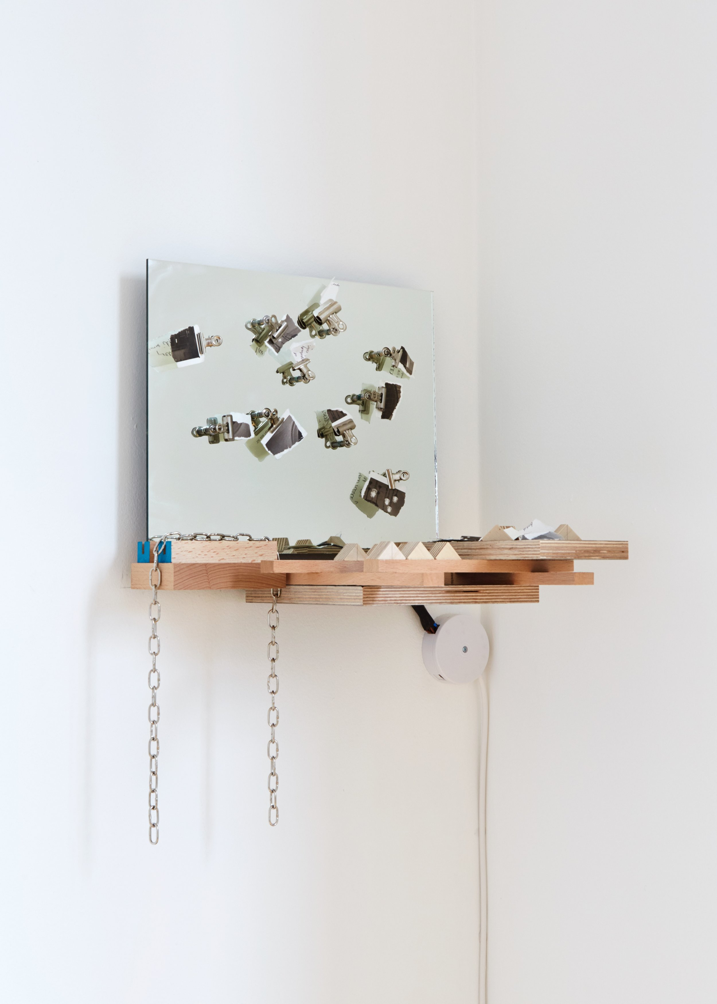 Trivial Matter  濕濕碎 ,  2019 Ash, Beach, Melamine Plywood, and Pencil on Plywood with Bath plug Chain, Torn Postcard and Written Notes, Assorted Bulldog Clips, Arduino and Electronics 55 x 38 x 32 cm