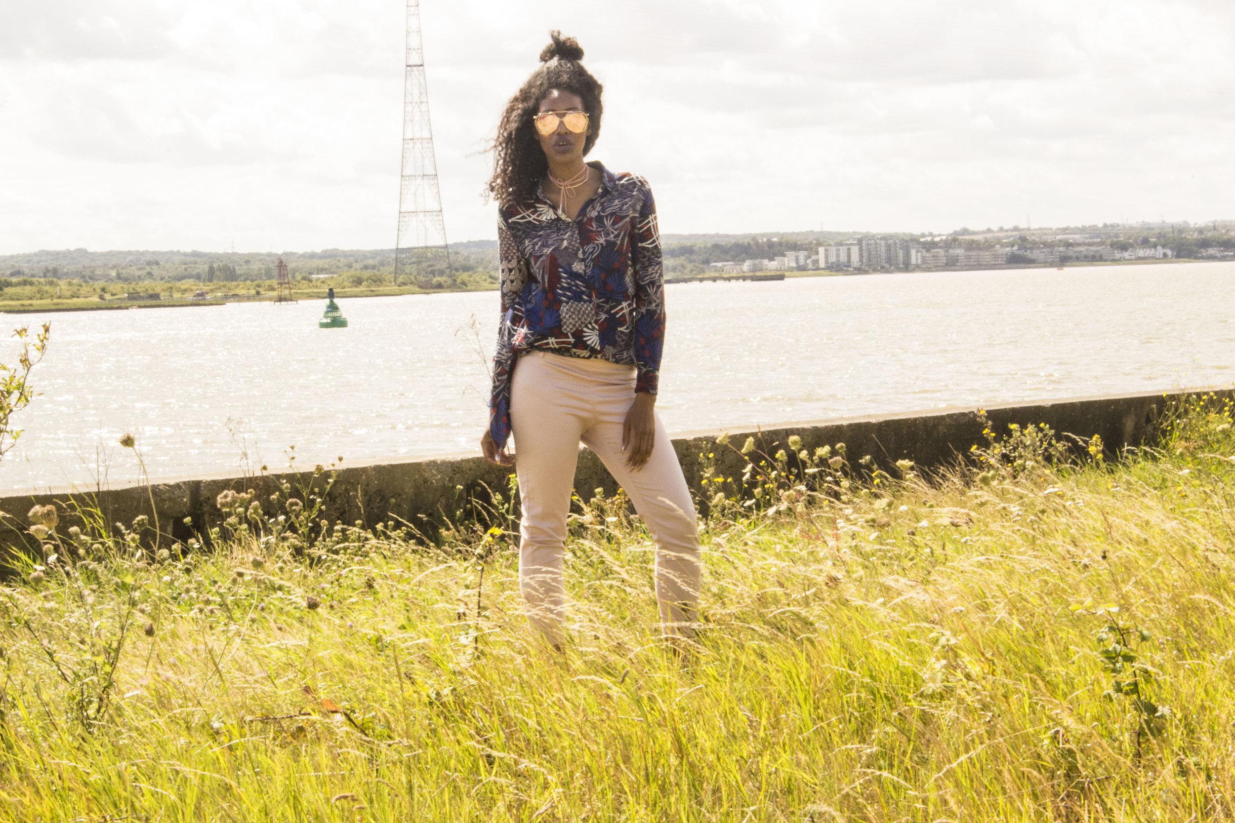 Blush trousers navy print shirt rose gold sunglasses