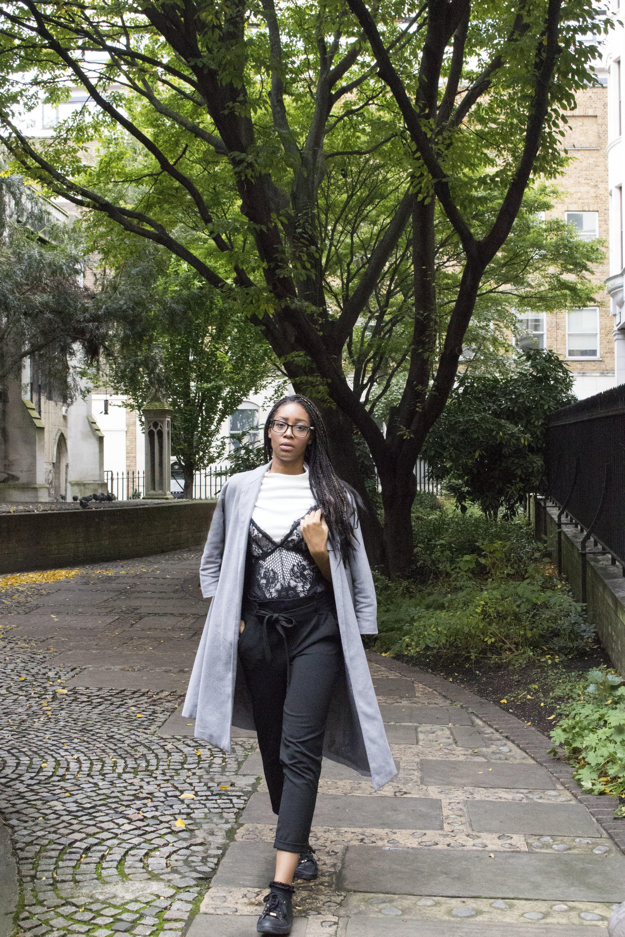 White polo neck black bodysuit black trousers black trainers grey coat for Autumn Winter