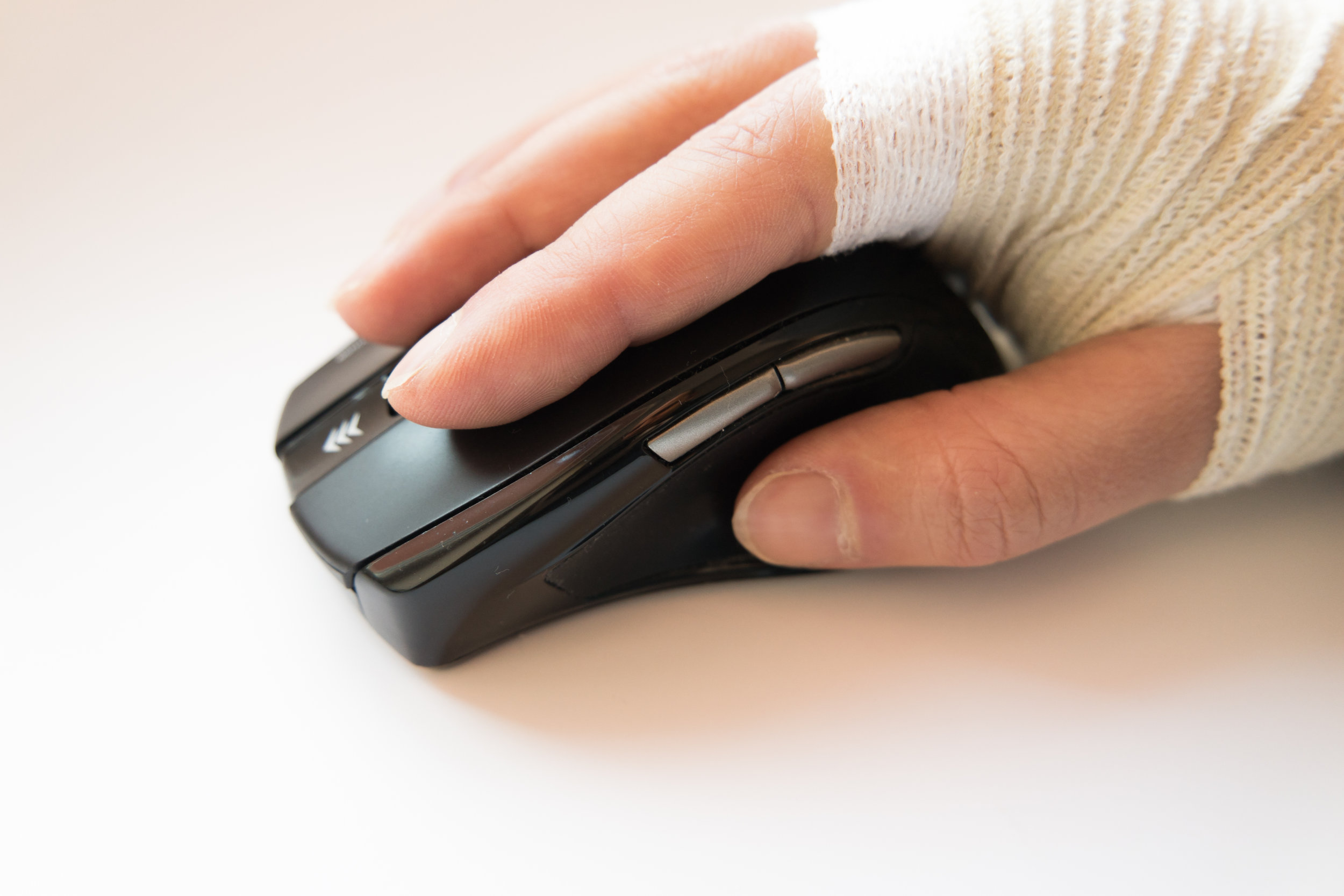 stock-photo-tied-hand-sick-and-sore-on-computer-mouse-carpal-inflammation-684773305.jpg
