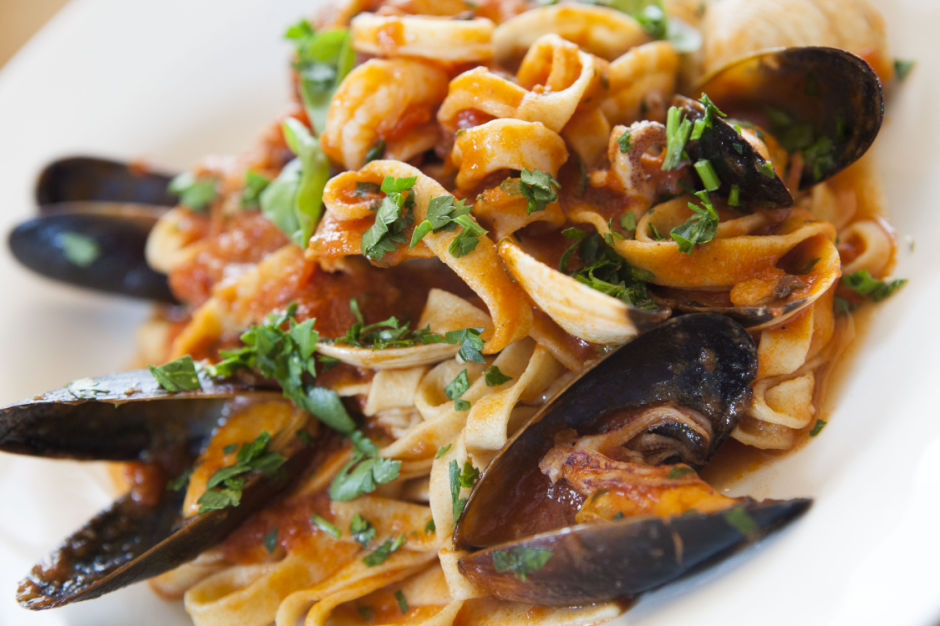 Give our Seafood Fettuccini a try - the noodles are prepared from scratch!