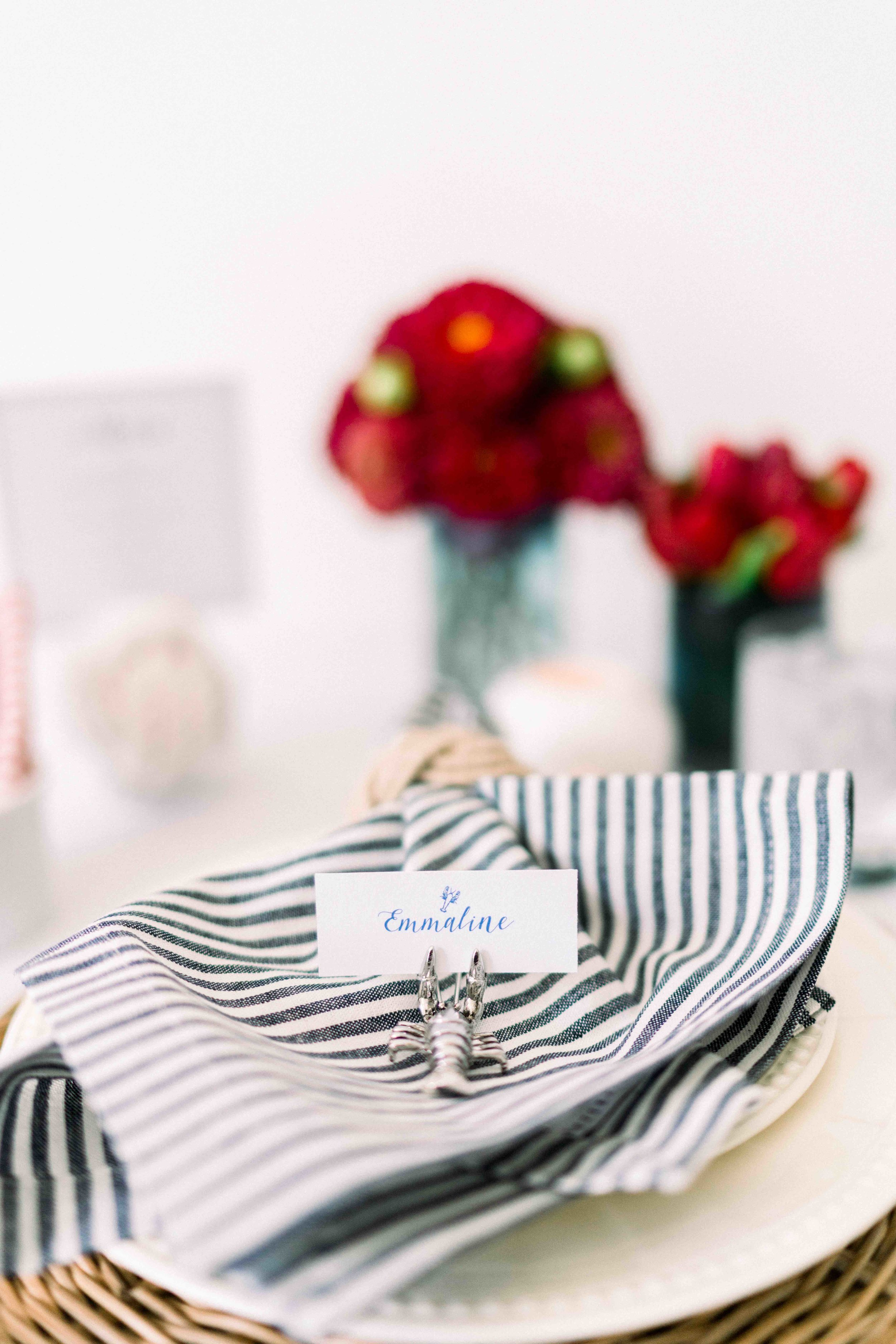 Blue and White Place cards and ticking stripe napkins and bold florals by Eco Chic Blossoms