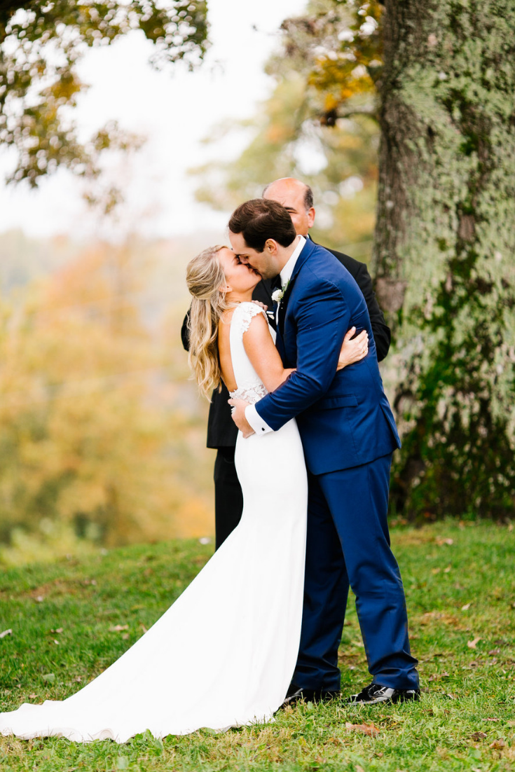 Stunning outdoor wedding under an old oak tree at Front Porch Farms just outside Nashville, Tennessee. Photo by Feiten Photography.