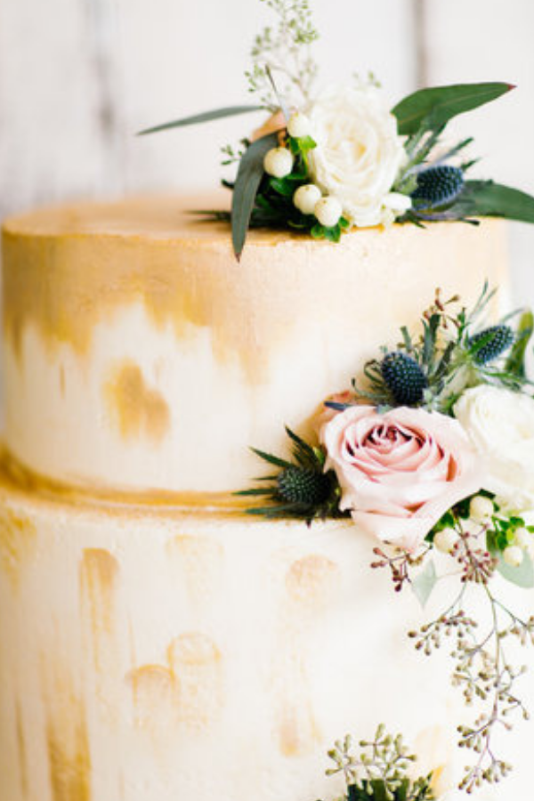 Gorgeous gold and blush wedding cake by Hygge Bakery Nashville. Photo by Feiten Photography.