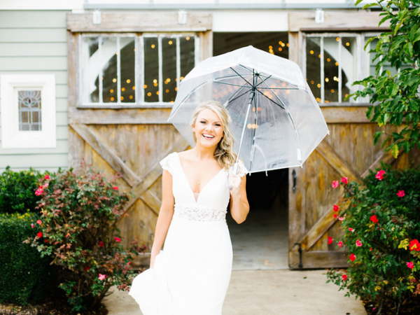 All smiles even in the rain!   Photo by Feiten Photography.