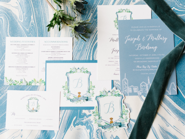 Full wedding suite by Prim + Pretty Prints with slate blues and greenery.   Photo by Feiten Photography..