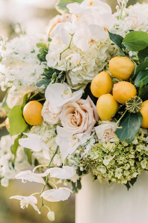 Ceremony Flower Arrangements with hydrangea, lemon, roses, orchids, lemons and greenery for Naples Botanical Garden Wedding.png
