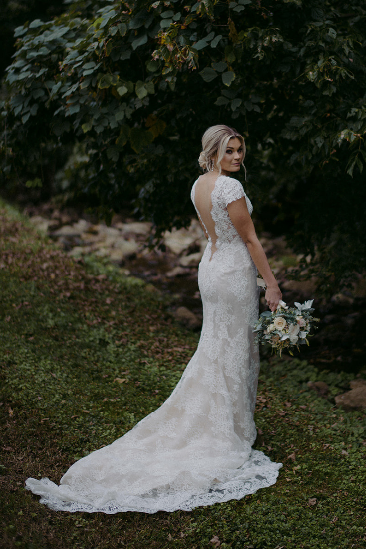 Real Wedding Airey and Jack at Drakewood Farm in Nashville Tennessee -bride at Drakewood Farm in lace wedding dress with cap sleeves fall weddings Prim + Pretty Prints 3.png