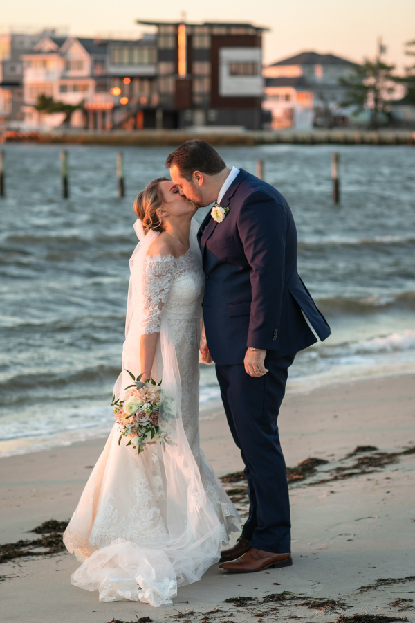 Real Wedding on Long Beach Island at Brant Beach Yacht Club -Bride and groom beach photo.png