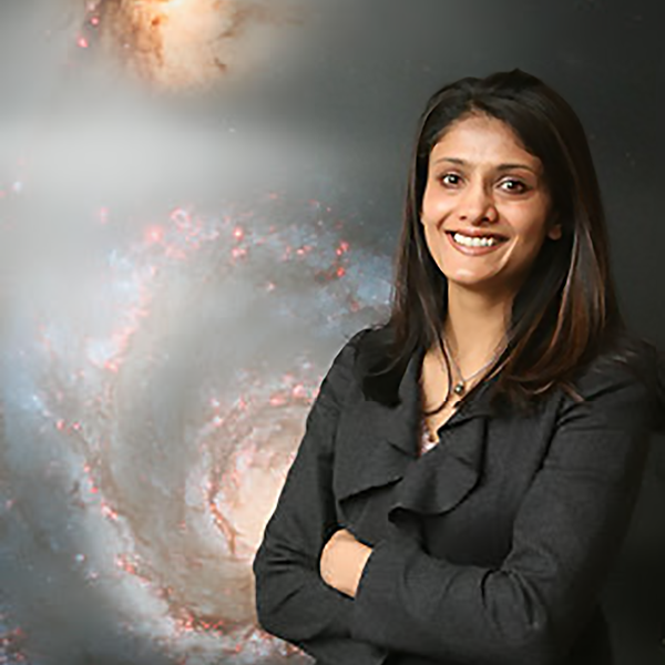 Dr. Rupali Chandar - Dr. Rupali Chandar is a professor of astronomy and Associate Chair in the Department of Physics & Astronomy at the University of Toledo. She received her PhD in astrophysics from Johns Hopkins University in 2000, and went on to postdoctoral positions at Space Telescope Science Institute (STScI) and Carnegie Observatories in Pasadena. Her research focuses on understanding how stars and clusters of stars form and change over time in nearby galaxies like our own Milky Way. She's been fortunate enough to work extensively with observations taken with the Hubble Space Telescope, which has given us the clearest view yet of nearby galaxies.