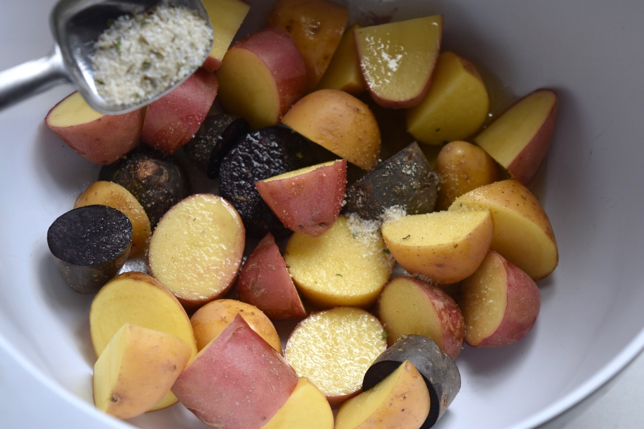 A splash of herb oil and this dry brine make crispy, slightly ranch-flavored spuds.