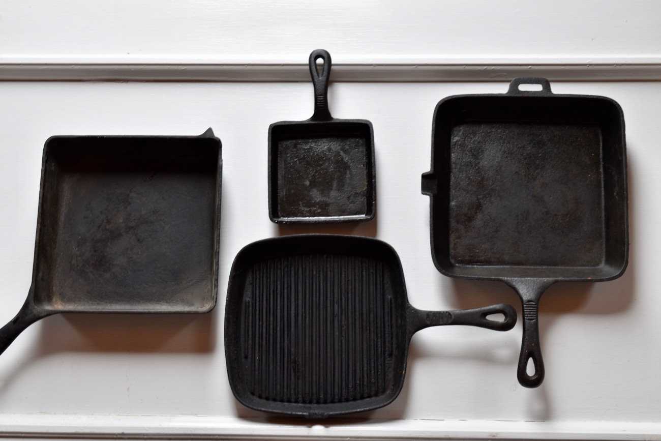 "Clockwise from far right: a 9"" square pan that's ideal for frying (note the pour spout), ridge grill pan, another 9"" square pan that's 2 1/2"" deep and ideal for baking; it's ""helper handle"" is wounded, but the pan works fine. Last but not least, a 5"" grilled cheese pan, also good for making square fried eggs for sandwiches."