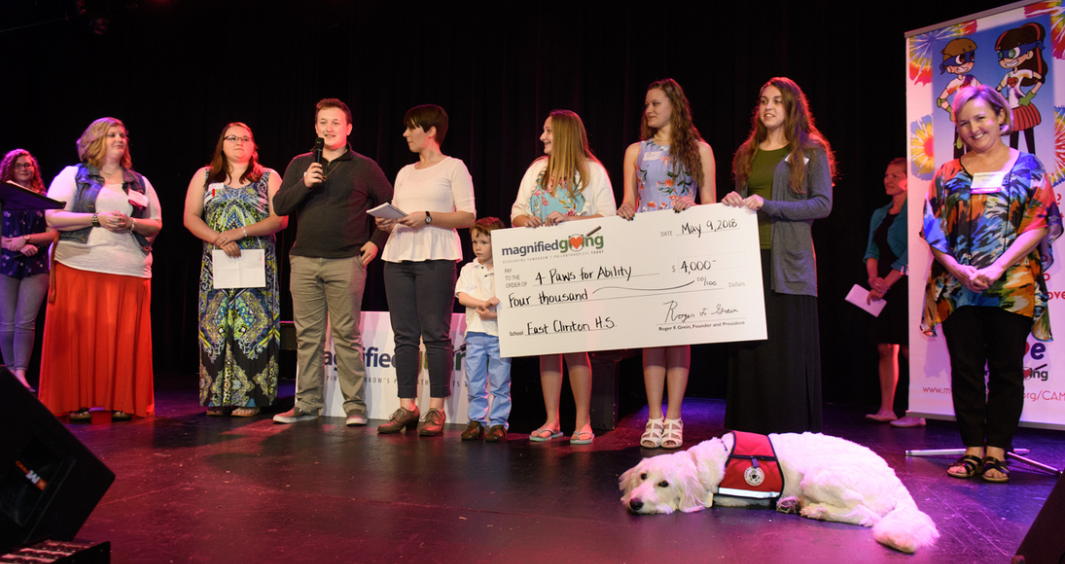 East Clinton High School, East Clinton, Ohio   The students worked together to raise enough additional funds to grant $4,000.00 to 4 Paws for Ability; allowing a family within in their community to obtain the service dog needed for their son with Autism.