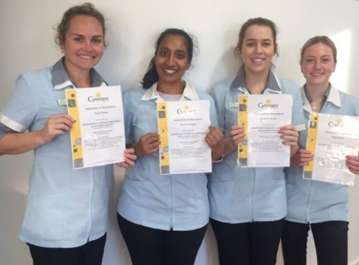 PROUD STAFF MEMBERS AND DR DINUSHA THALAGLA WITH THEIR CERTIFICATES