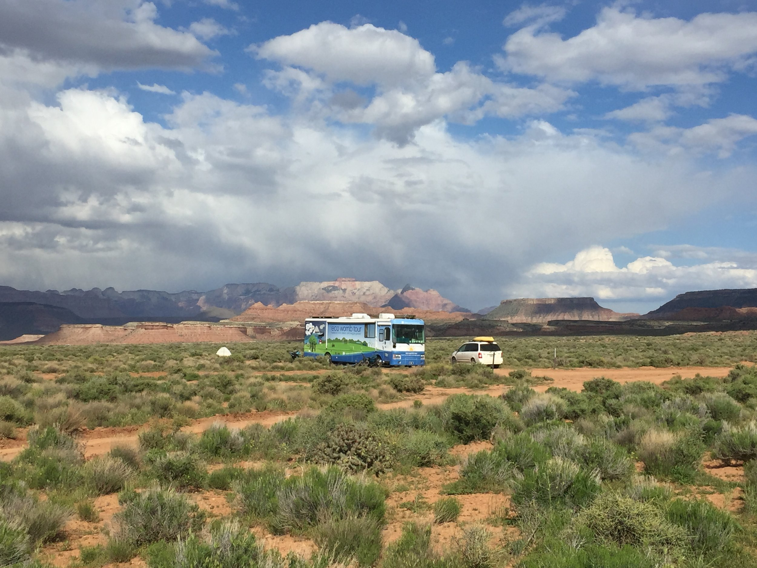 Chilling at the campsite and observing a storm over Zion Canyon, in the distance behind the Eco Womb.