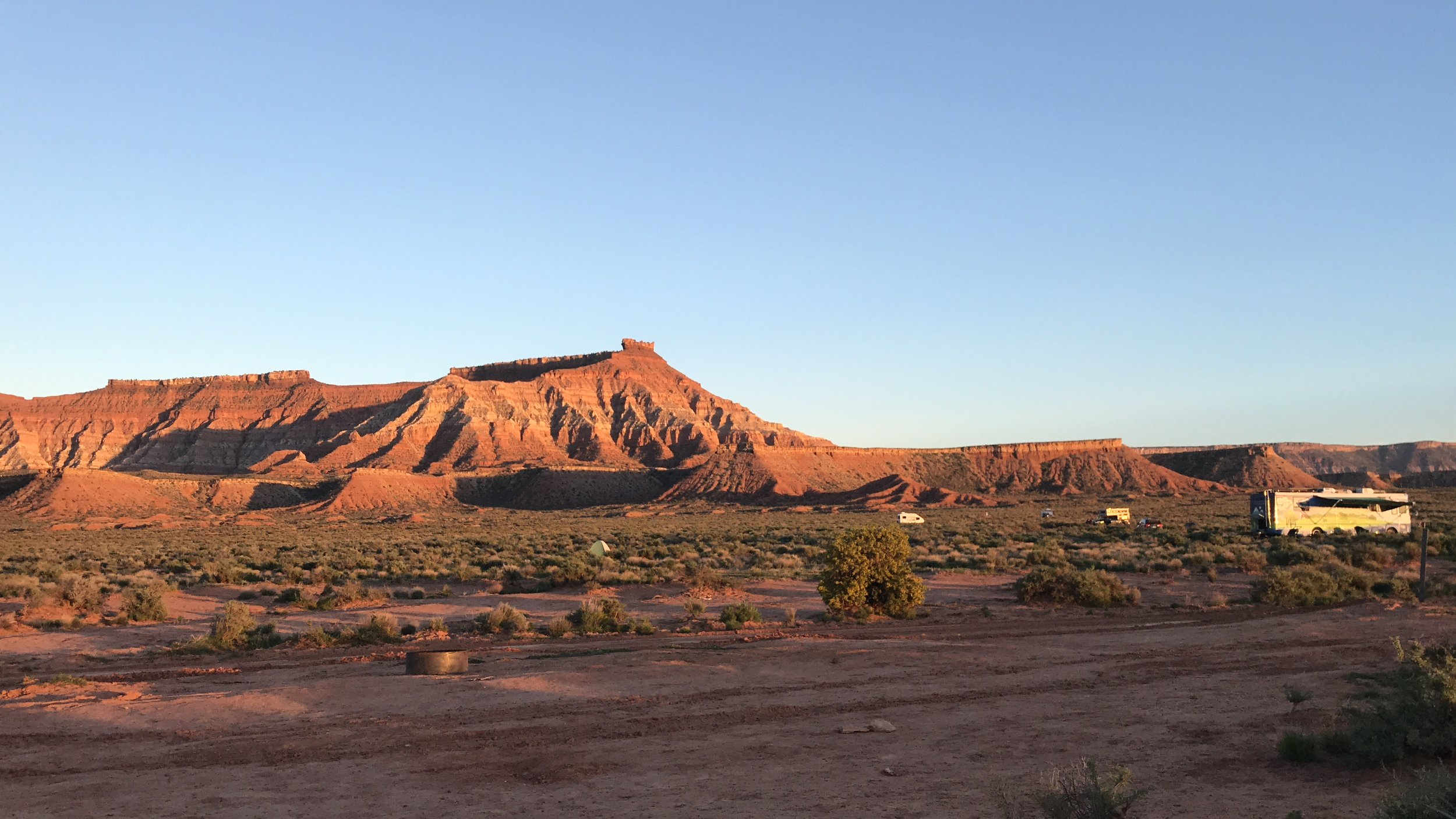 Gooseberry Mesa lit up by the setting sun. That's the Eco Womb on the right!