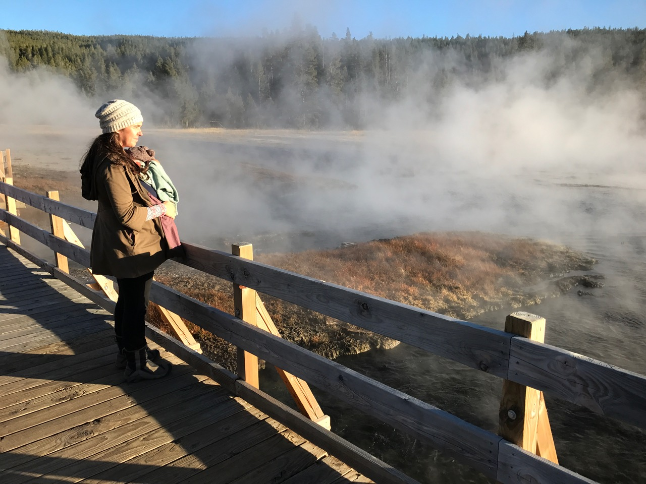 Admiring the steam at the Hot Lake area of the park