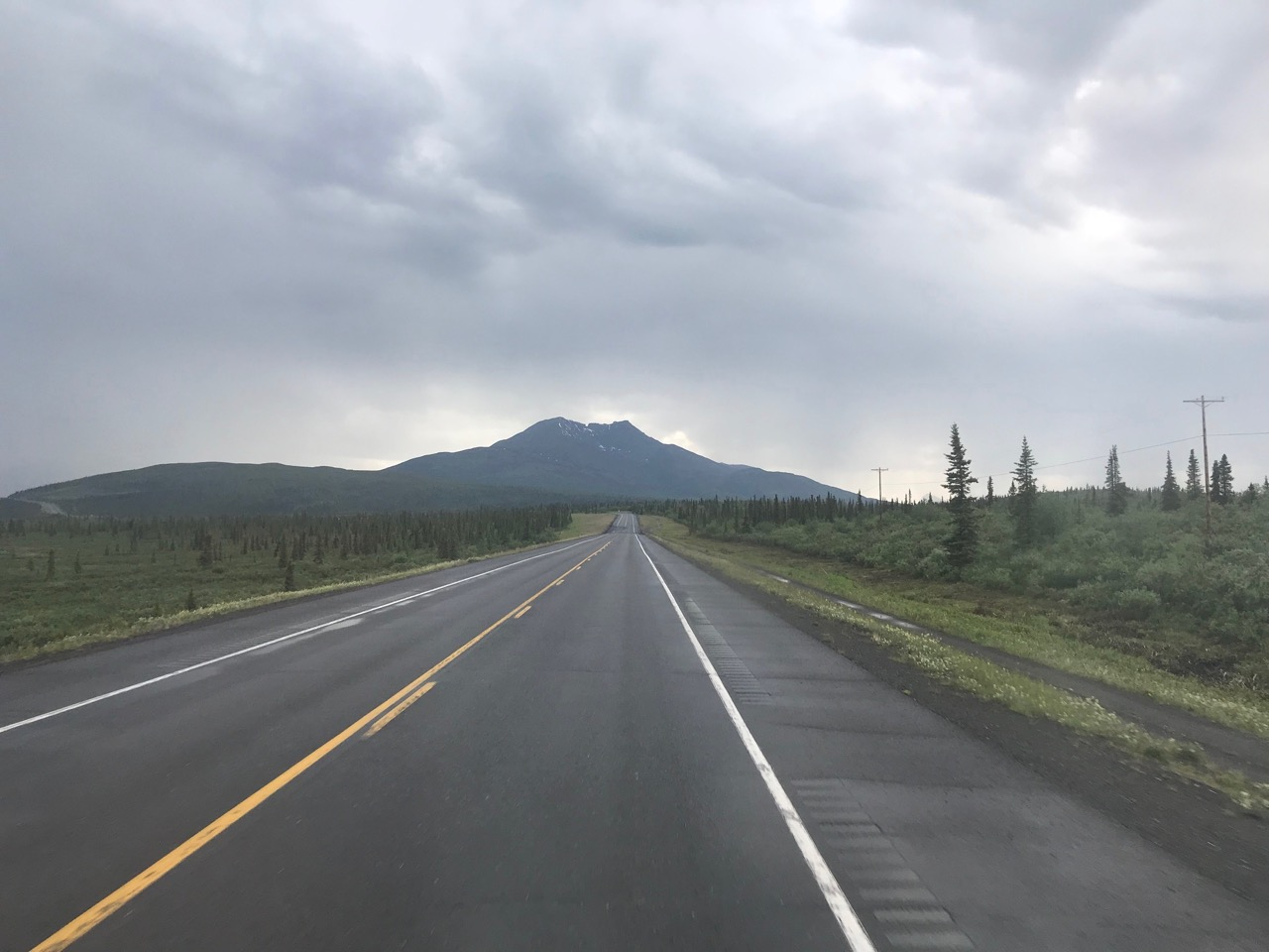 Headed west on the Glenn Highway, with Gunsight Mountain in the distance.