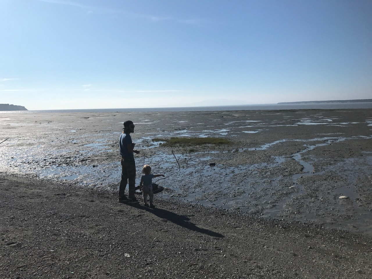 Connor and Izzy look out over the mudflats of Knik Arm. The mud can be like quicksand out there, thats why we stayed on the beach.