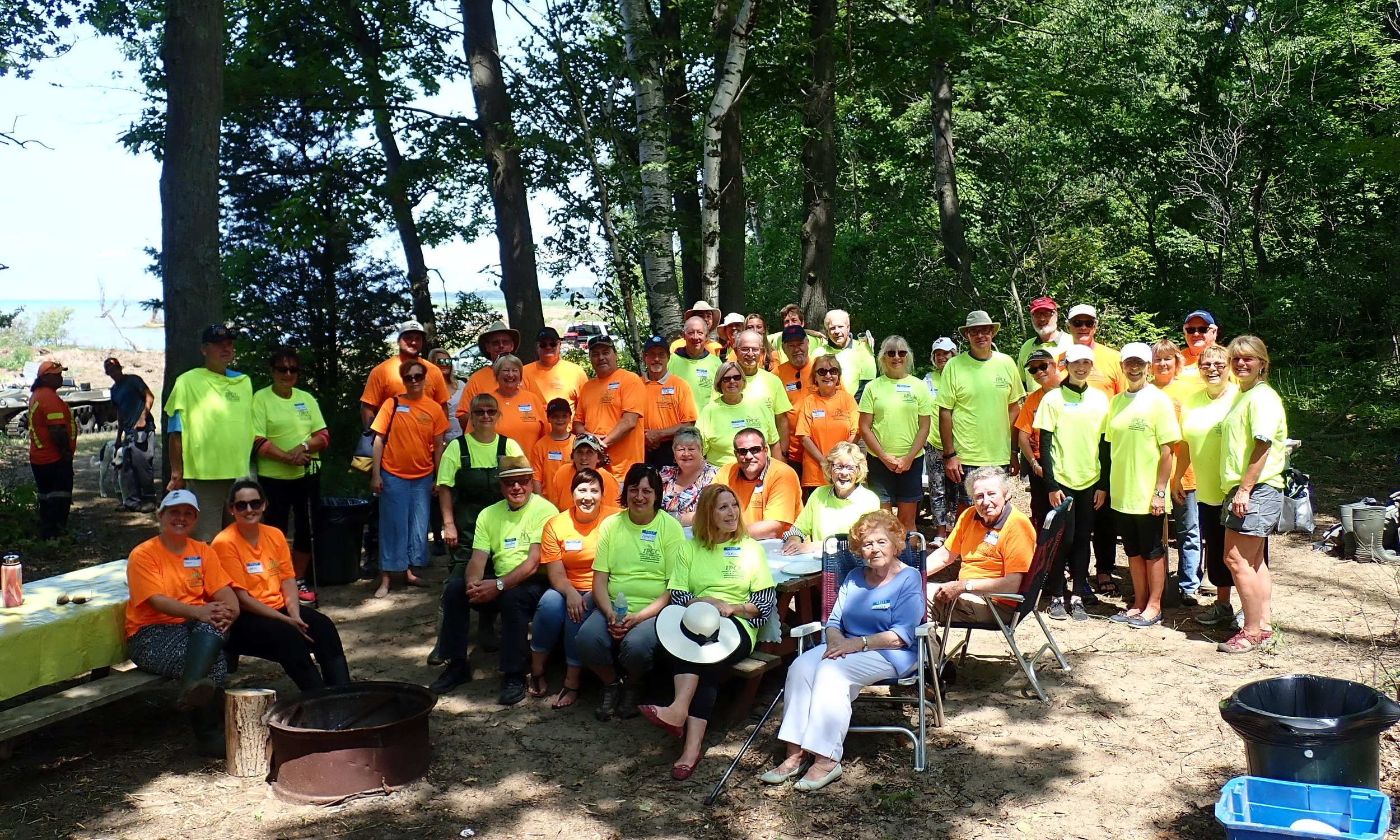 Volunteers have lunch and stop for a photo during a large  Phragmites  control event at Lambton Centre.