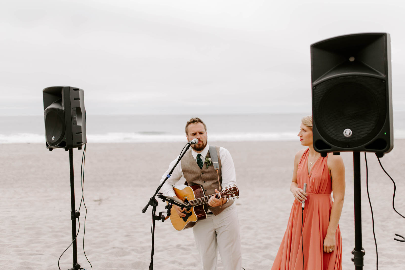 pacific city cape kiwanda community center oregon coast wedding beach feminist queer lgbtq photographer jamie carle lgbt overcast sunny harsh sun reception pink bridesmaids dresses