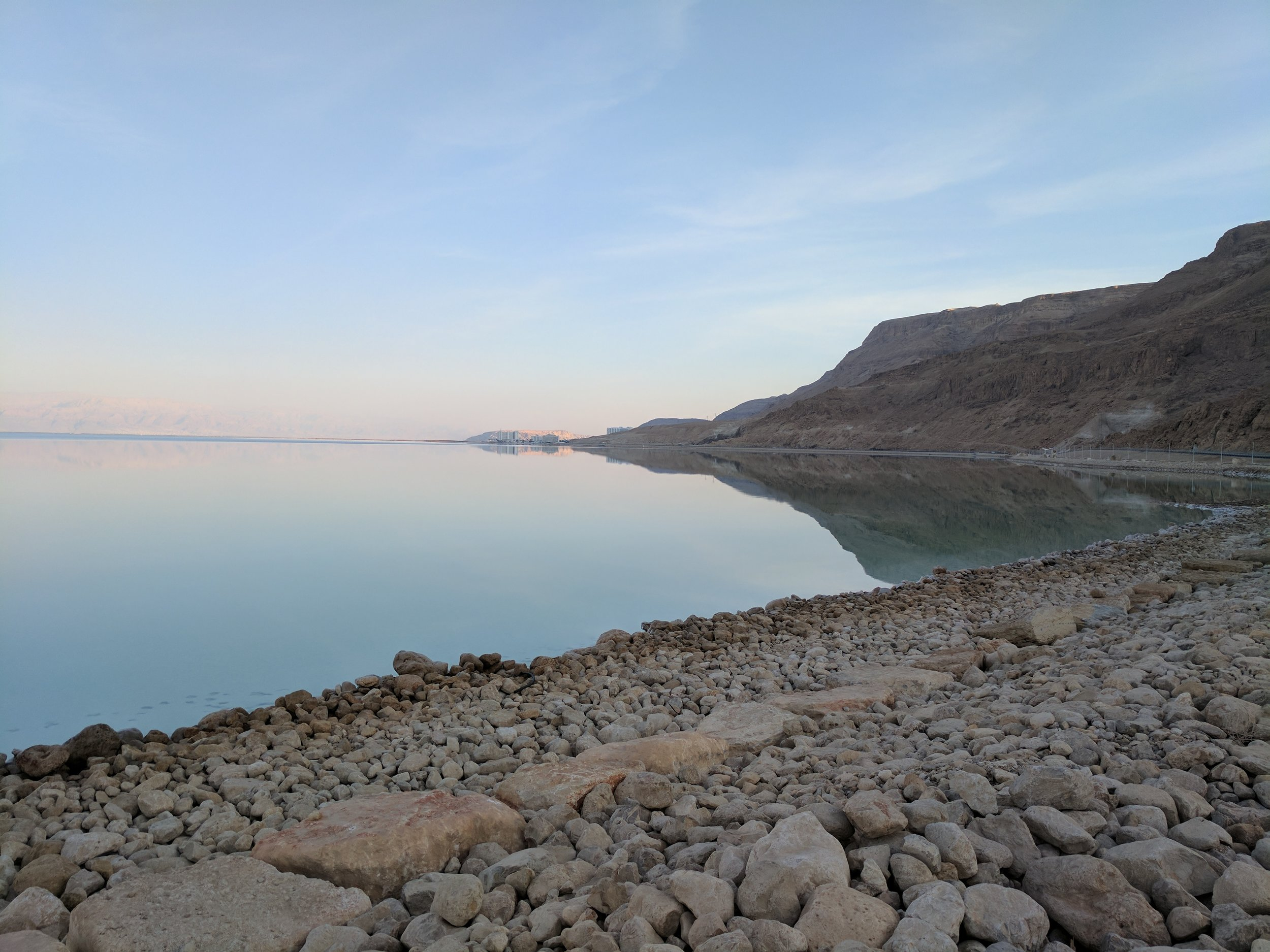 The Dead Sea, with Jordan (the hazy cliffs on the left) in the background