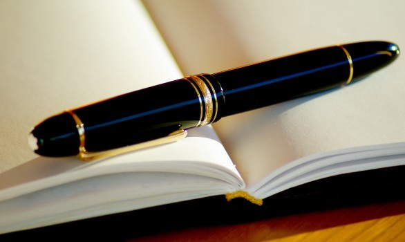 pen-ink-fountain-pen-writing-open-book-pages.jpg