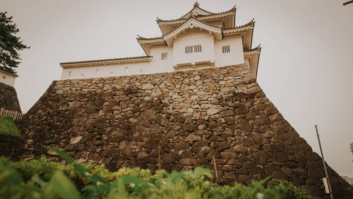 The Kofu Castle sits perched atop a stone wall.