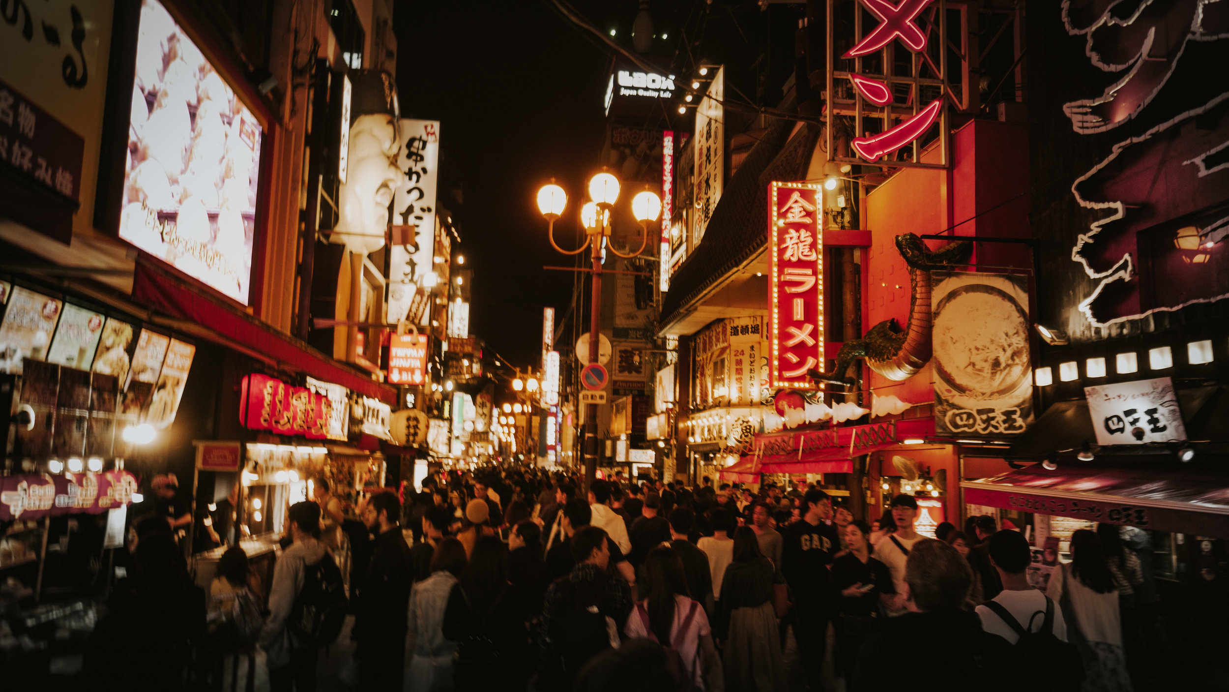 The lively crowds fill the streets of Dotonbori.