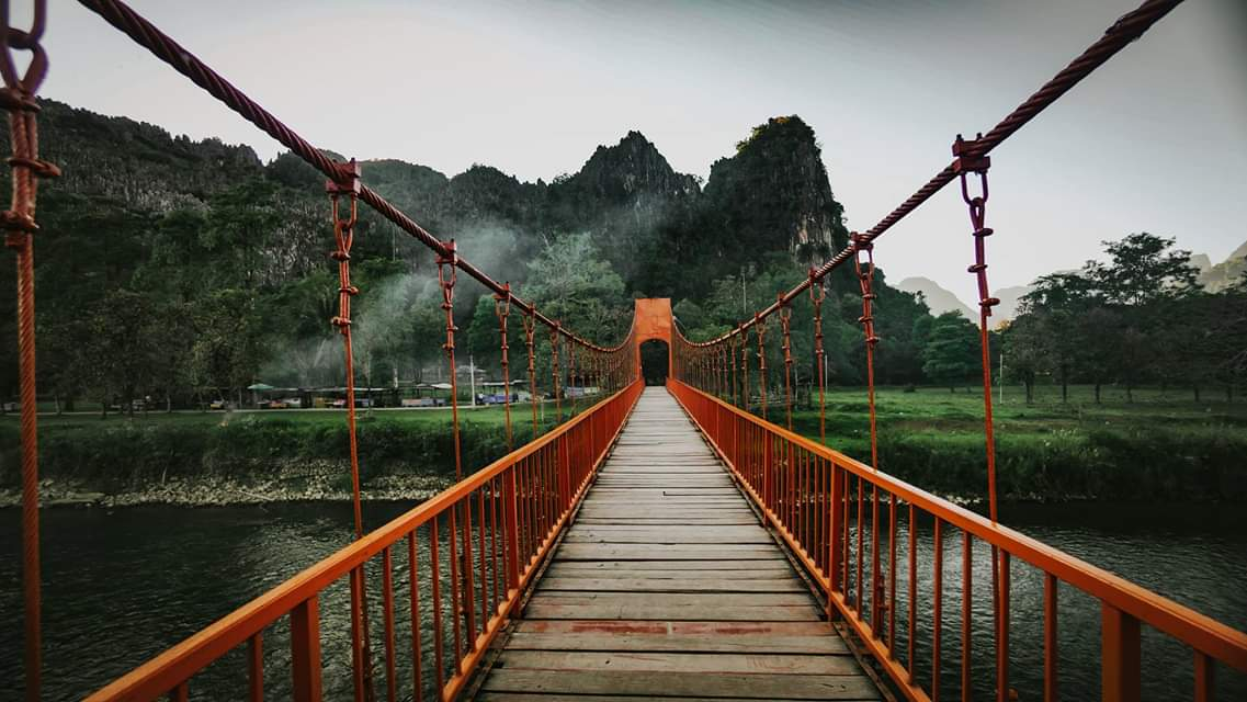 Bridge across the water leading to the Jang Cave
