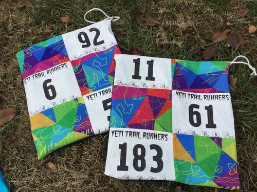 Get a bad ass bag, made from race bibs. -