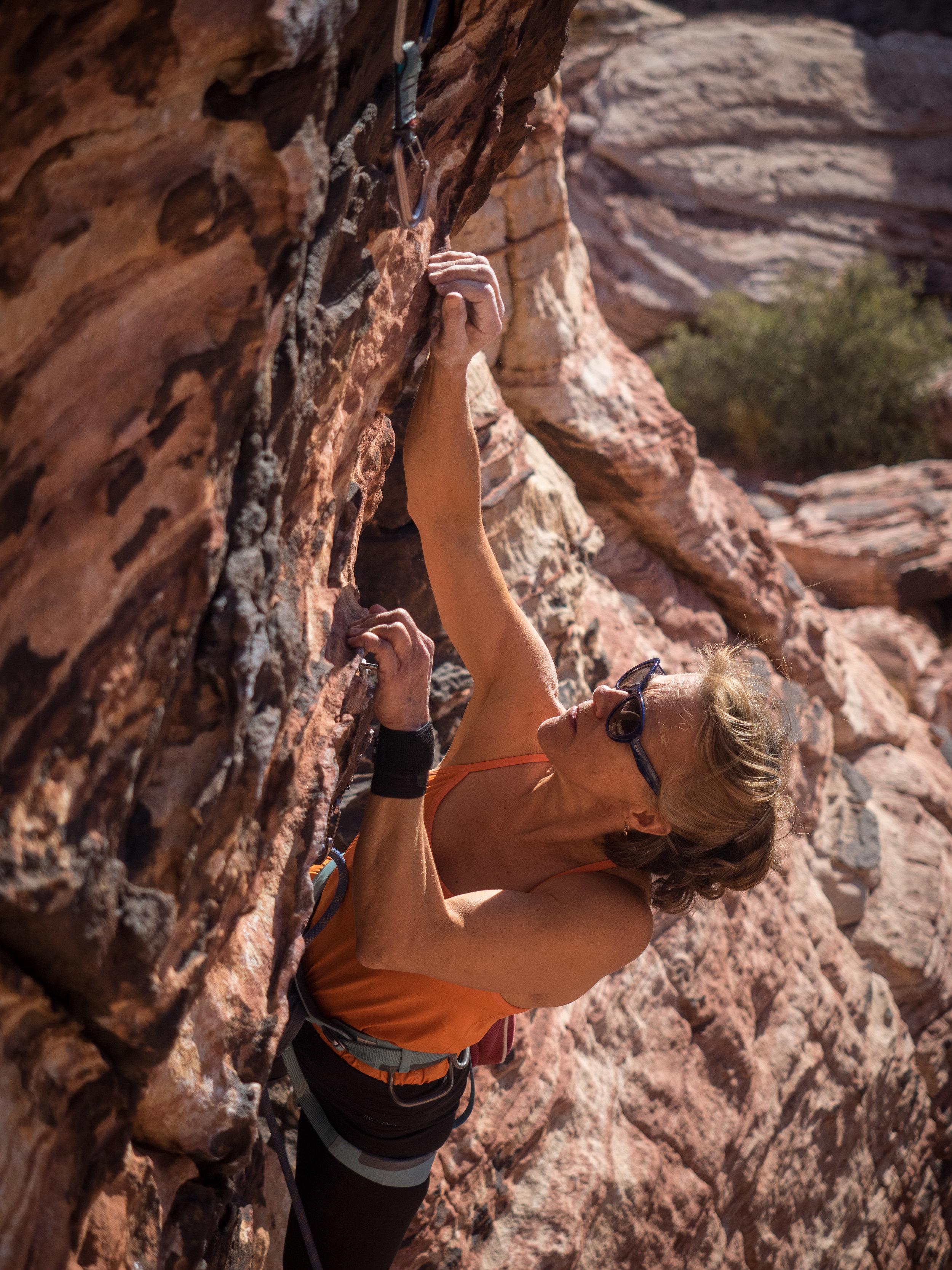 Glenna latching the nextt key hold in Red Rocks, NV-- photo courtesy of the LC