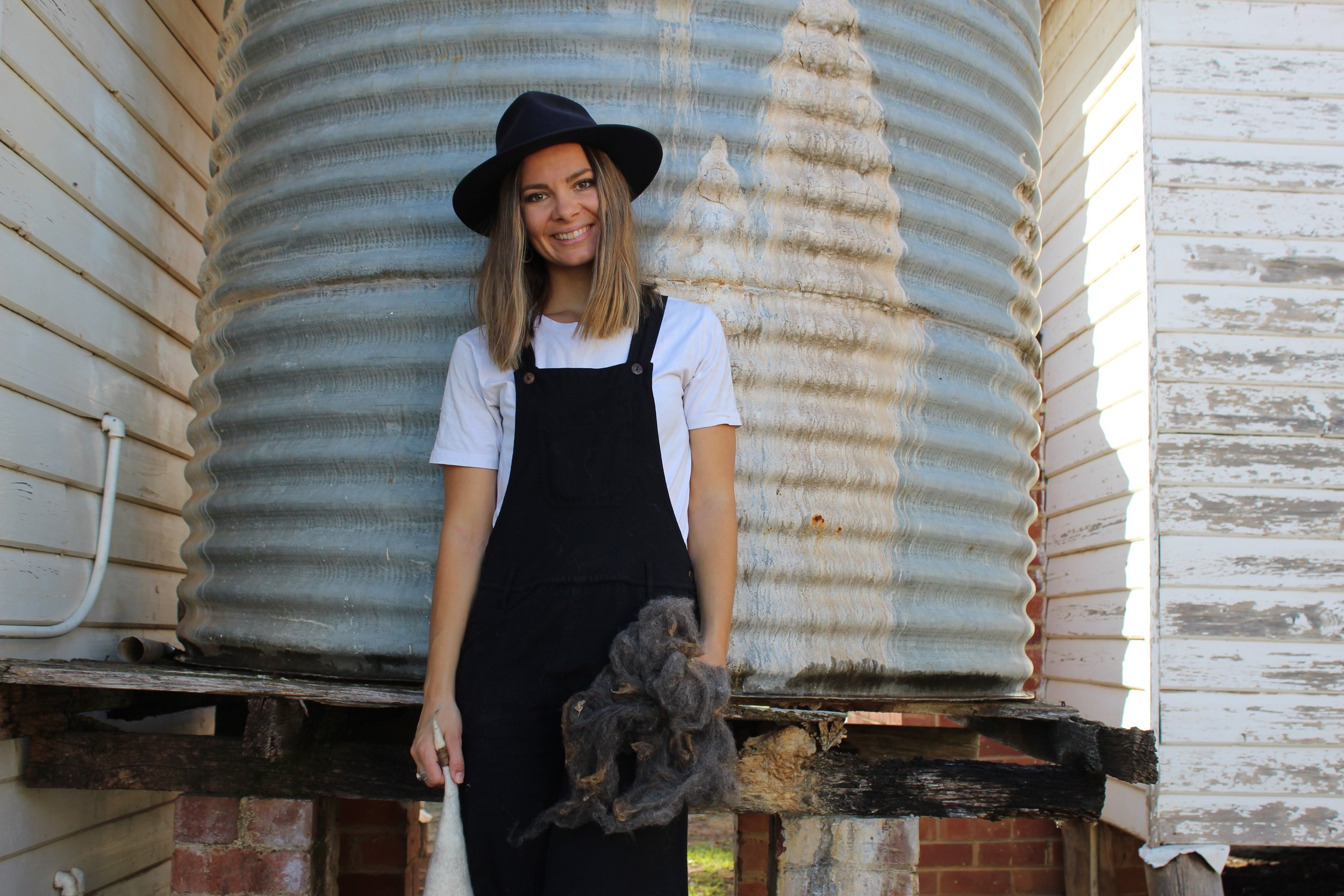 Jess with freshly shorn wool at her studio in Bungendore, rural NSW Australia.