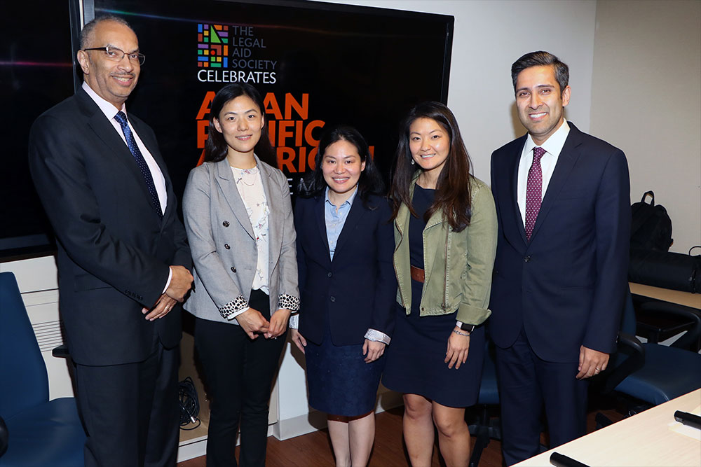 (from left) Seymour W. James, Jr., Attorney-in-Chief; Zimei Weng, Chinese Interpreter and translator in the Criminal Defense Practice; Jona Cosio, Staff Attorney in the Queens Neighborhood Office of the Civil Practice; Carolyn Kwon, Assistant Attorney–in-Charge in the Bronx Office of the Juvenile Rights Practice; and Sateesh Nori, Attorney-in-Charge of the Queens Neighborhood Office.