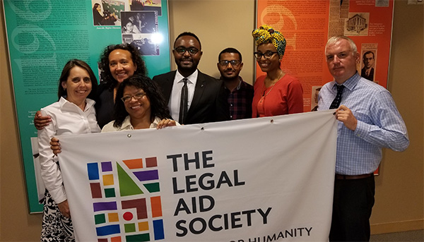 In the picture, left to right are: Mary Lynne Werlwas, Karen Hamberlin, Marlen Bodden, Mr. Mekuriya, Mr. Kitila, Jane-Roberte Sampeur, and Peter Mitchell. William Gibney and Richard Blum attended but are not in the photograph.