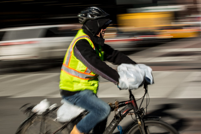 """Chen Qixiong, 56, delivering food on his throttle-controlled e-bike in Midtown this past winter. """"For us delivery guys, we don't make that much money,""""    Chen told Gothamist   . """"To fine us $500, that's a whole week's worth of money gone."""""""