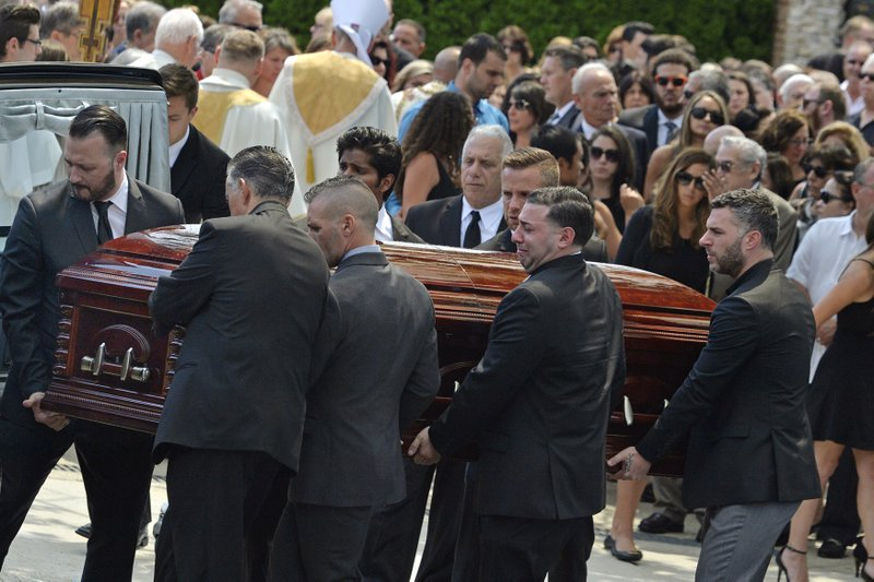 In this Aug. 6, 2016, file photo, mourners carry the casket of Karina Vetrano from St. Helen's Church following her funeral in the Howard Beach section of the Queens borough of New York. Jury selection is expected to start Tuesday, March 11, 2019, in the retrial of Chanel Lewis, accused of killing Vetrano. (Steven Sunshine/Newsday via AP, File)