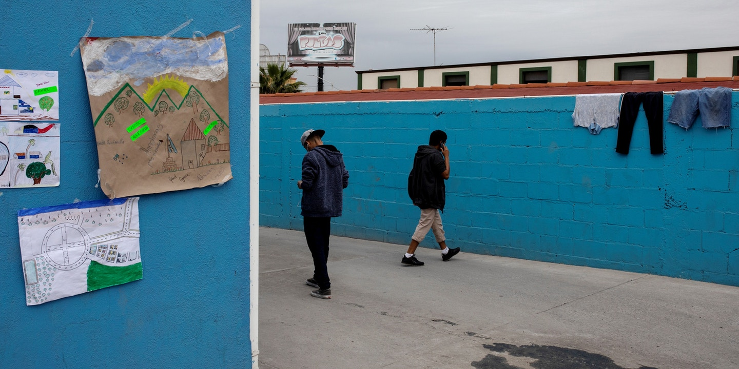 A pair of teenage boys in the yard of a migrant shelter for unaccompanied minors in Tijuana, Mexico, on Dec. 5, 2018. Photo: Alkis Konstantinidis/Reuters