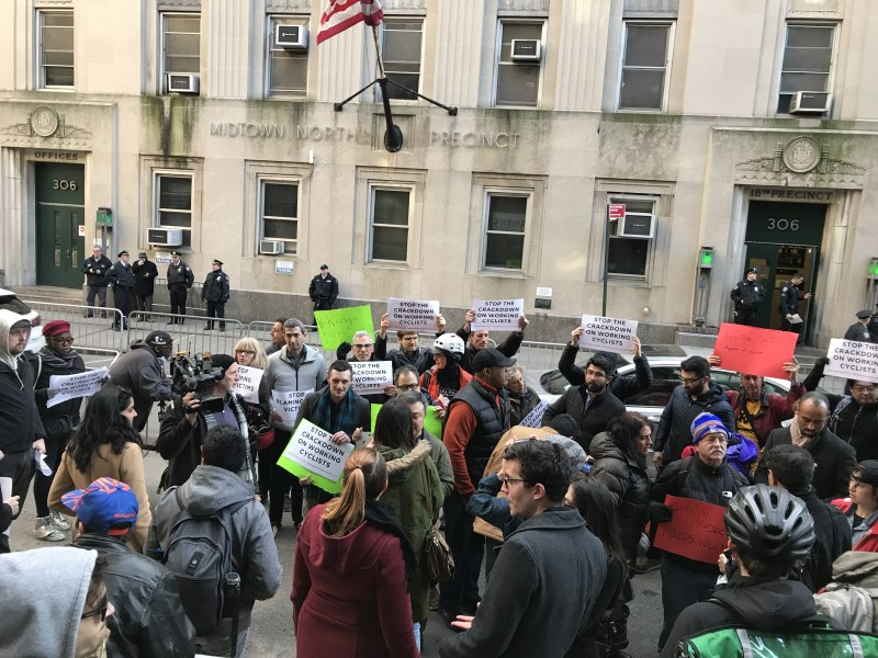 Earlier this year, cyclists and advocates rallied against the NYPD crackdown on e-bikers at the Midtown North stationhouse. Photo: Gersh Kuntzman