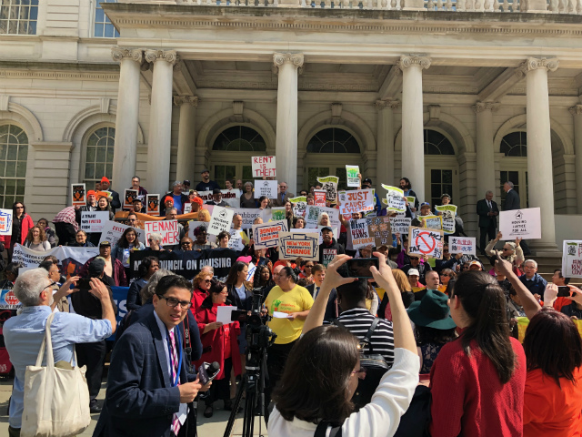 Tenants and state representatives gather outside City Hall before they testified at a state hearing on rent reform laws in Lower Manhattan on Thursday (Emma Whitford / Gothamist)