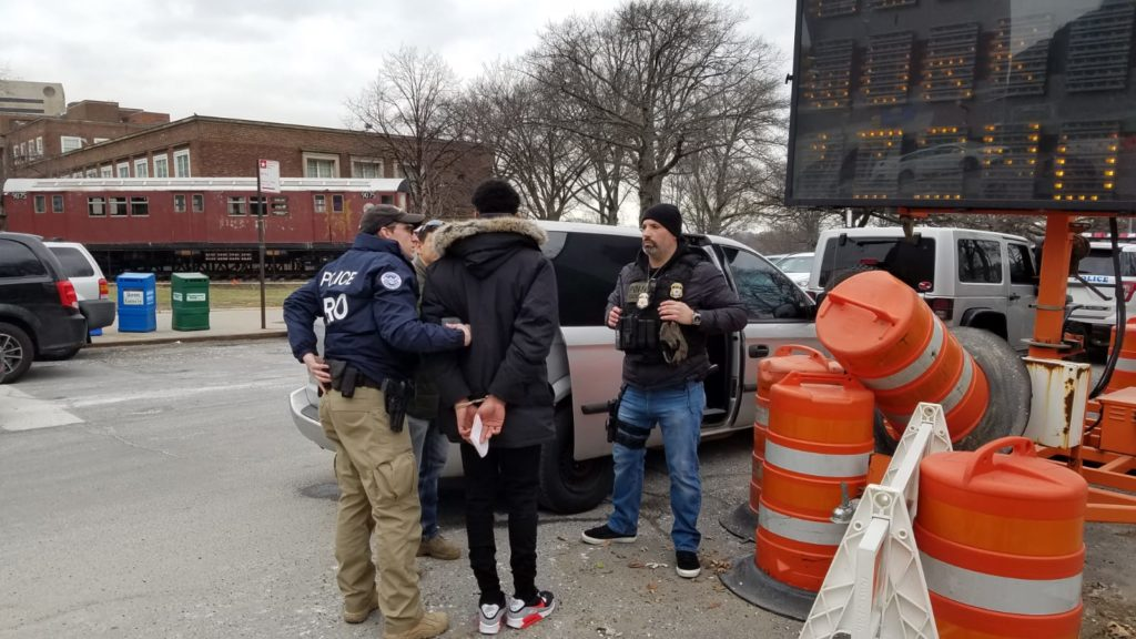 ICE agents arrest an immigrant outside Queens Criminal Courthouse in January. Photo obtained by the Eagle