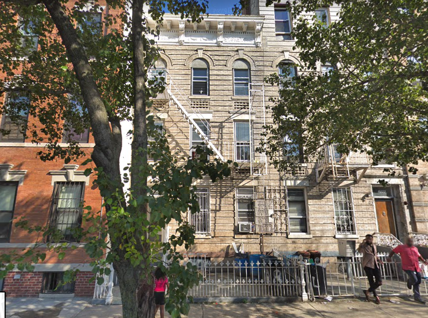 The Eastern Parkway building (center) has 299 open violations, according to HPD. Image via Google Maps