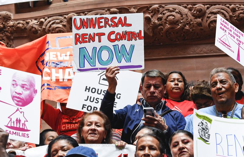 Tenants and members of the Upstate Downstate Housing Alliance from across the state, demand New York Gov. Andrew Cuomo and state legislators pass universal rent control legislation that would strengthen and expand tenants rights across the state of New York before rent laws expire on June 15th during a protest rally at the state Capitol on Tuesday in Albany, N.Y. (Hans Pennink/AP)