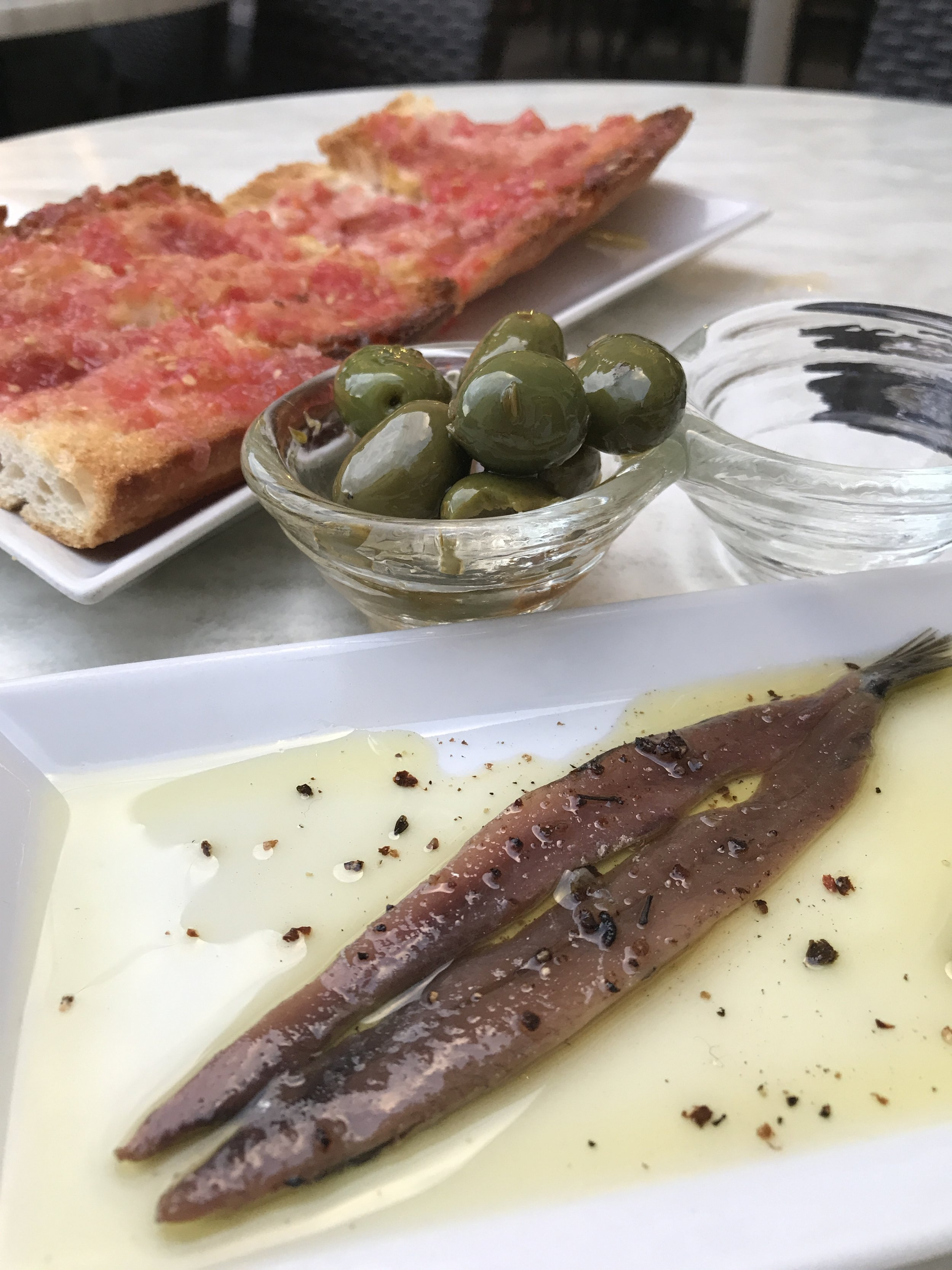 One perfect anchovy, olives, and  pa amb tomaquet