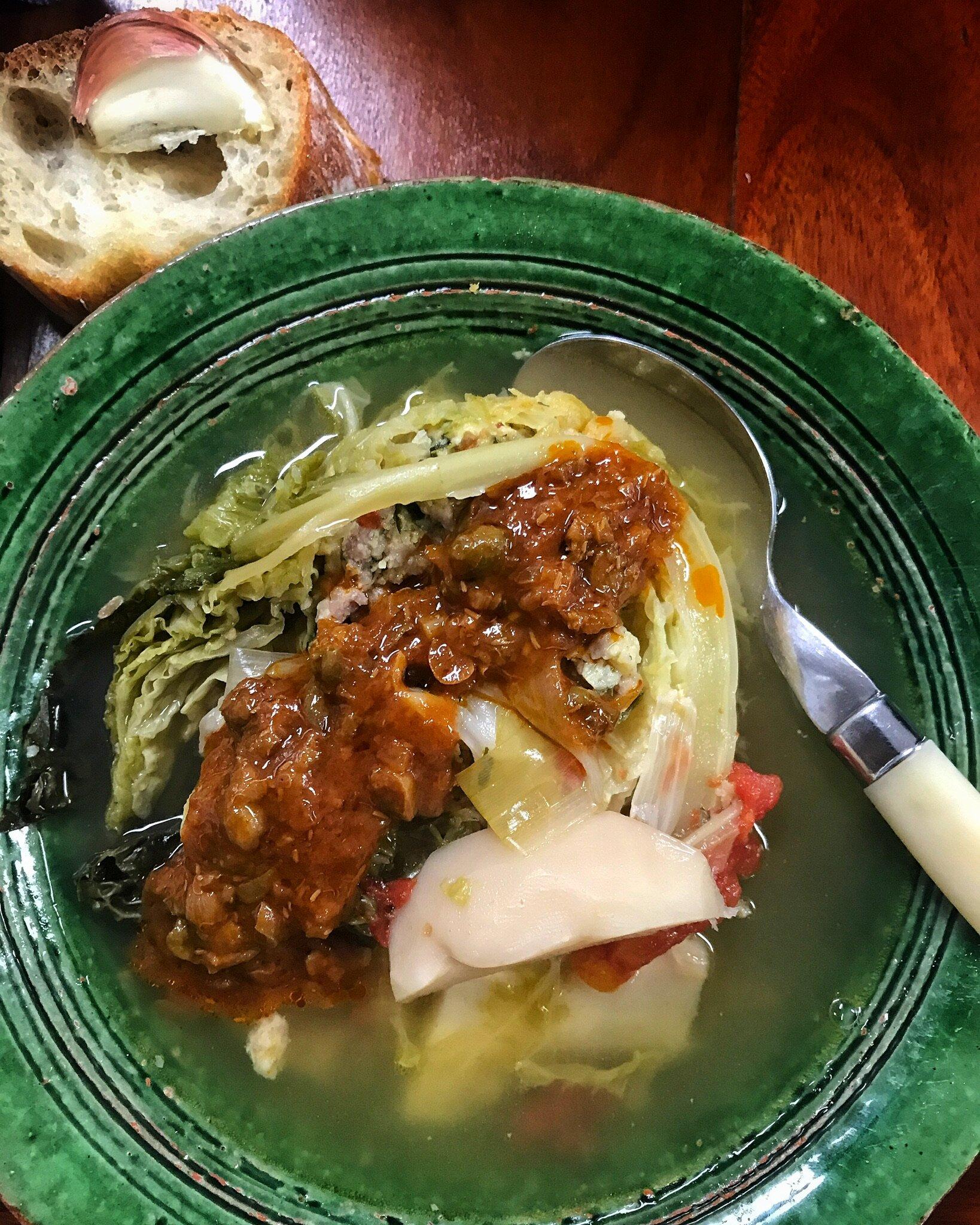 a slice of Poule Verte with it's Tomato Caper Sauce.