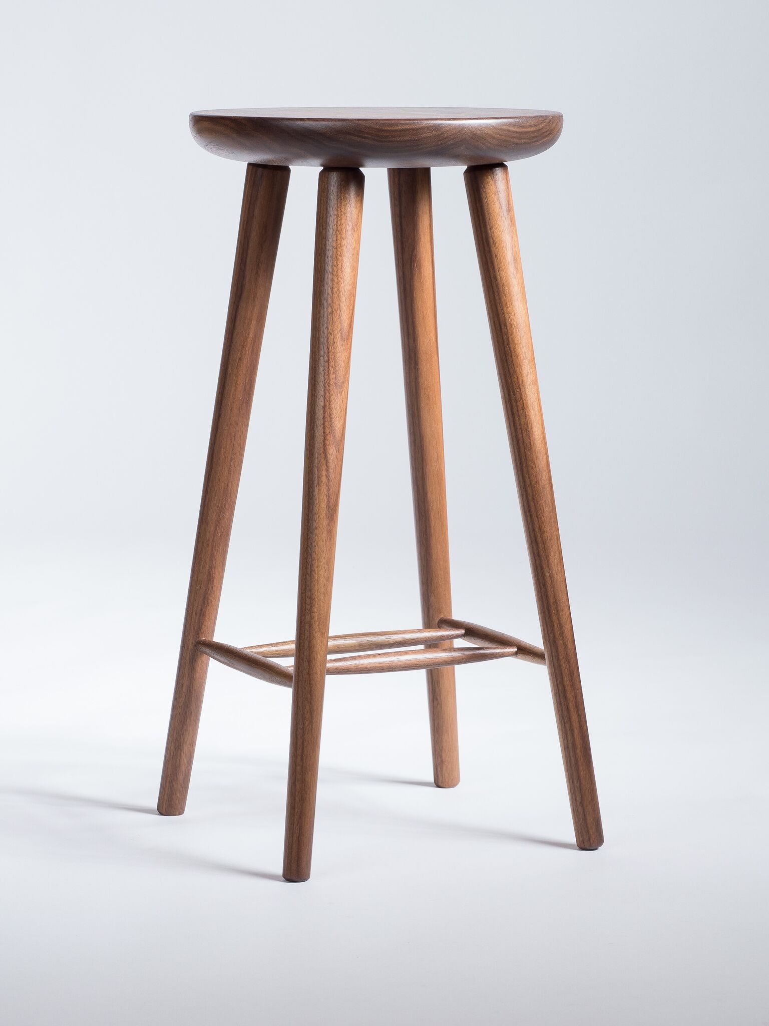 Contemporary Contour - The stool's minimal design pairs well with bar tops, cafes and kitchen counters.