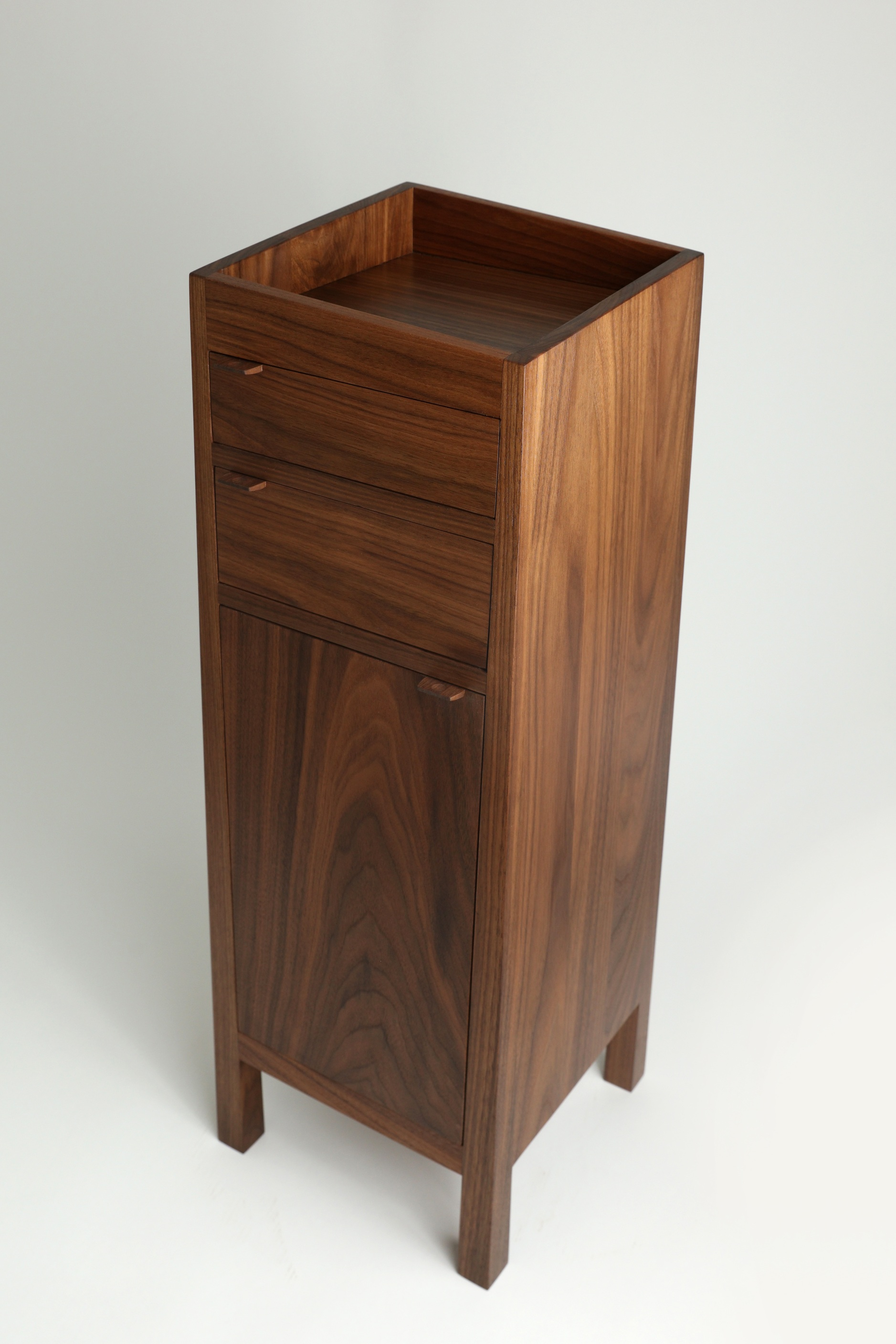 Entryway Stand - This case piece is well-suited to live near an entryway where your favorite objects can be placed in its top tray, drawers and cabinet.The Entryway Stand's clean, modern design makes for a nice accent piece for the home or office.Its drawer and cabinet space also make it an ideal night stand.
