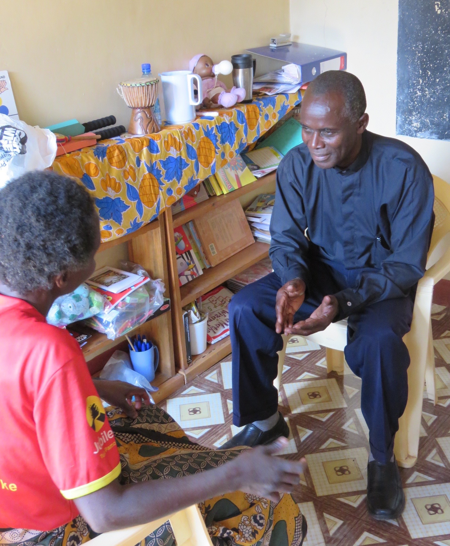 Pastor Garama counselling at the Faraja Community Centre