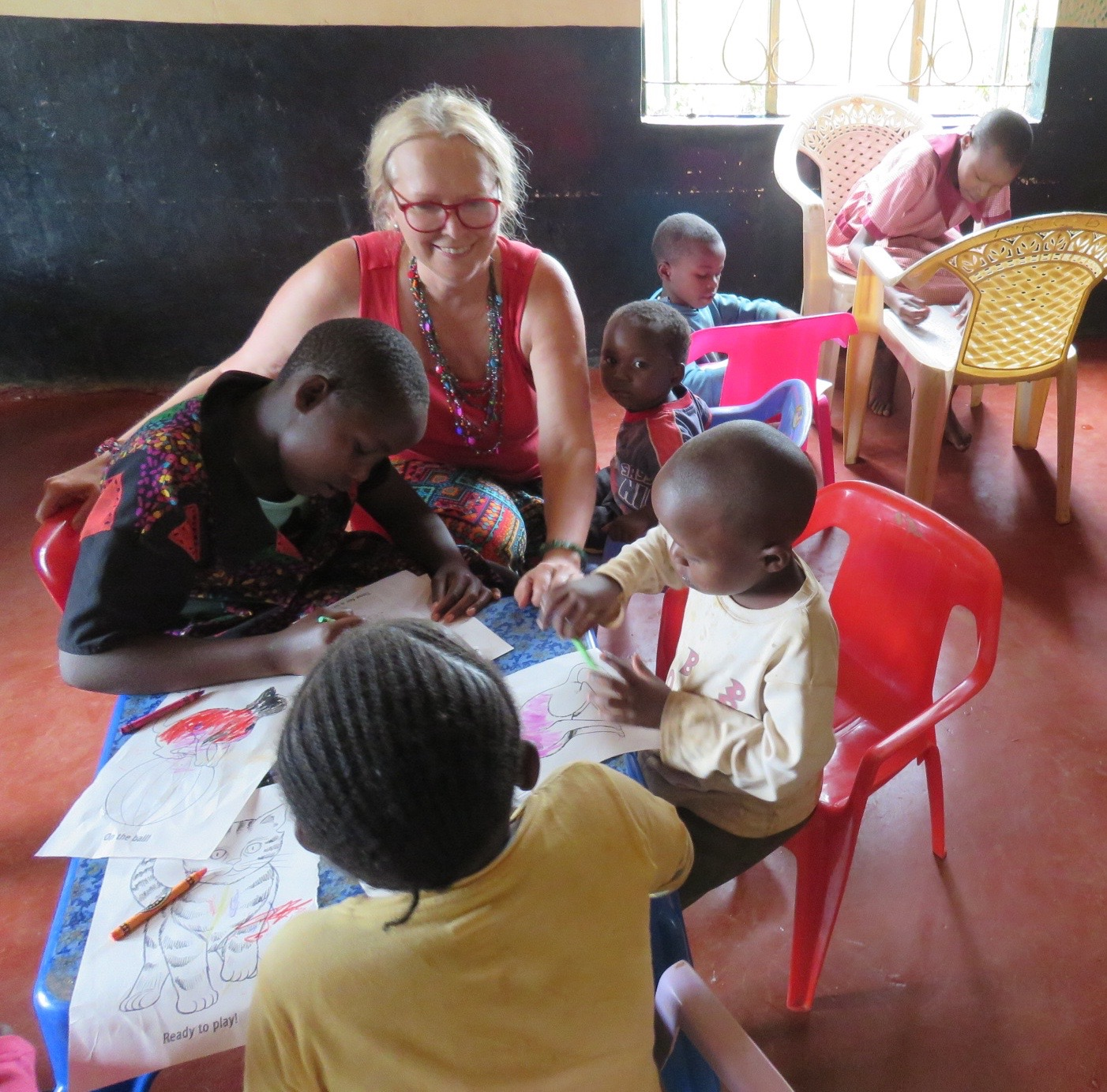 Friend of Faraja, Diane from the UK enjoys colouring with the children