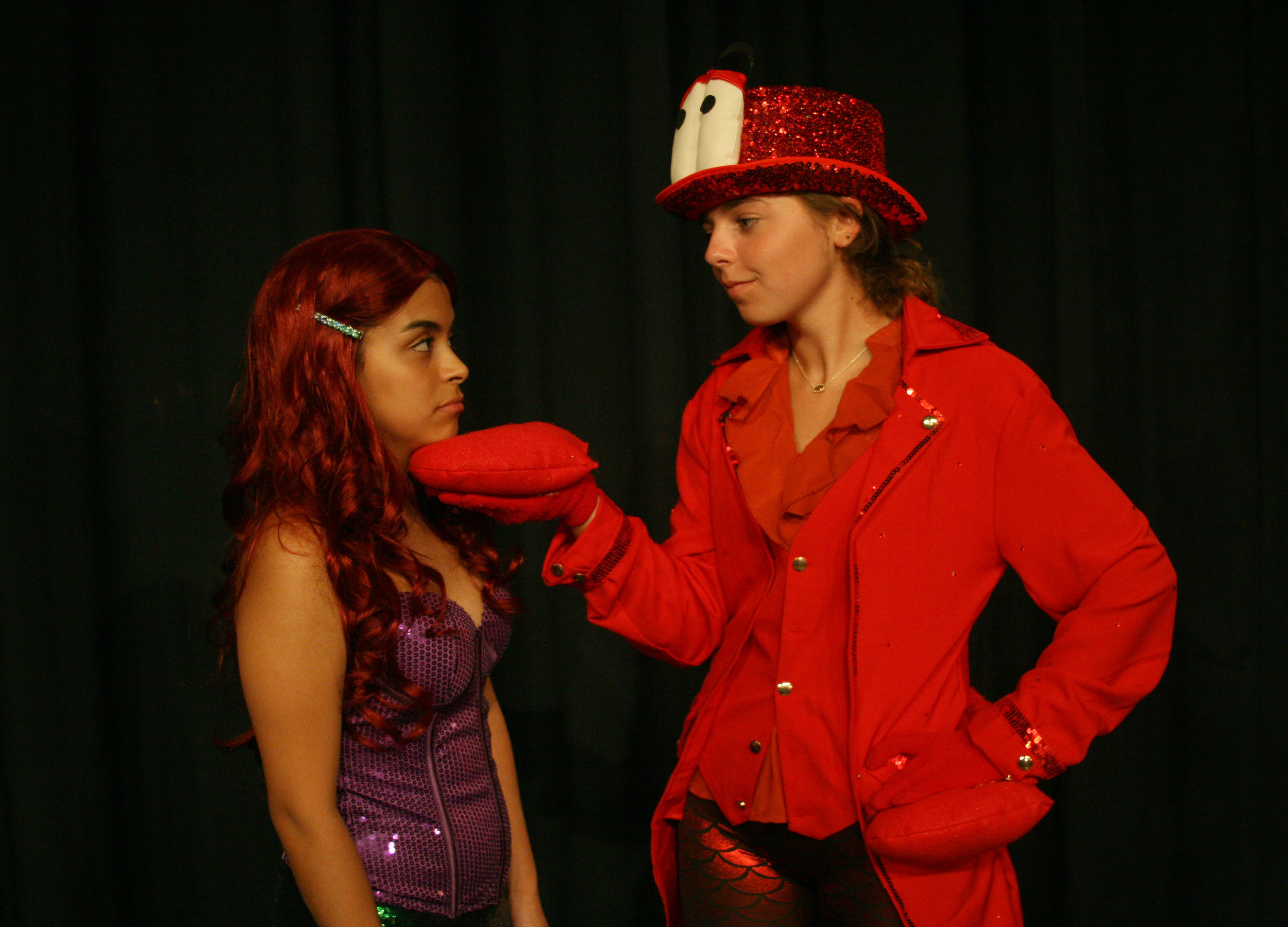 Sebastian the crab (Lindley Andrew) reminds Ariel (Jennifer Trejo Benitez) about her responsibilities to her father's undersea kingdom.